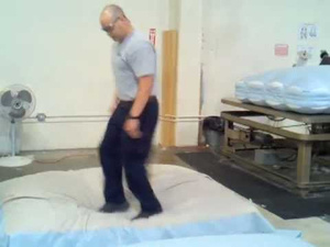 Walking on a Bed Is Apparently an Important Part of Making a Mattress